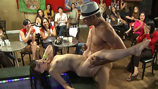 A dude performs for a crowd of screaming women in club and humps