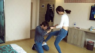 Chinese ballbust in tight jeans