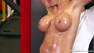 Blond oiled MILF babe with round boobies performs solid BJ to her fitness trainer