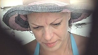 Mature white lady in blue bikini pisses in the public toilet room on the beach