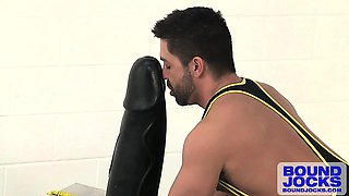 Dominic services a giant rubber dildo while fucking himself