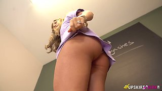 Lecherous nurse in sexy uniform Natalia Forrest shows off her pussy upskirt