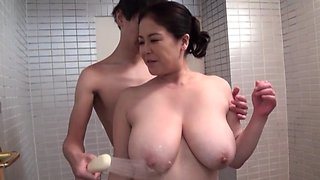 Chubby Japan mom bends over for a young cock