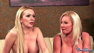 Gorgeous blonde women in erotic stockings, Amber Jayne and Michelle Thorne are sucking a hard dick