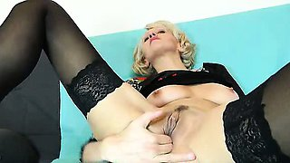 Sava teasing her shaved cunny with a thick black plastic