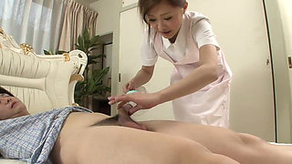 Sexy Nurse jerks her patient's cock as a treatment