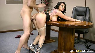 Hottest of all office workers enjoys the doggy action on the table