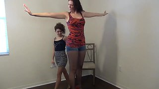 Small brunette cutie gets her ass spanked by a kinky friend
