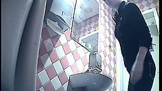 Blonde white stranger woman in the public toiletroom pisses