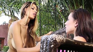 Glamour lesbian models tribbing outdoors