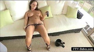 Teen brunette shoving a black dildo in peachy twat