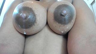 Dark milk tipped dripping black tits