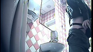 White chick in leather jacket and black pants pisses in the toilet room