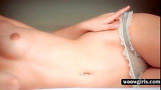Cutie stripping sexy undies in bed