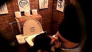 Pretty Japanese babe takes a cock for a ride in the toilet