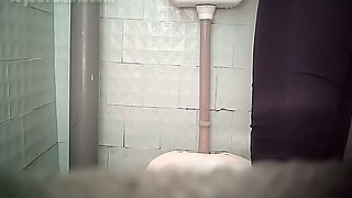 Redhead white stranger lady in the toilet room pissing in front of hidden cam