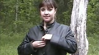Lewd plump MILF exposes her tits and gets ready to pee outdoors